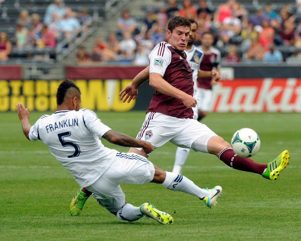 . COMMERCE CITY, CO. - JULY 27:  Rapids midfielder Dillon Powers battled for the ball with Galaxy defender Sean Franklin in the first half. The Colorado Rapids hosted the Los Angeles Galaxy Saturday, July 27, 2013.  Photo By Karl Gehring/The Denver Post