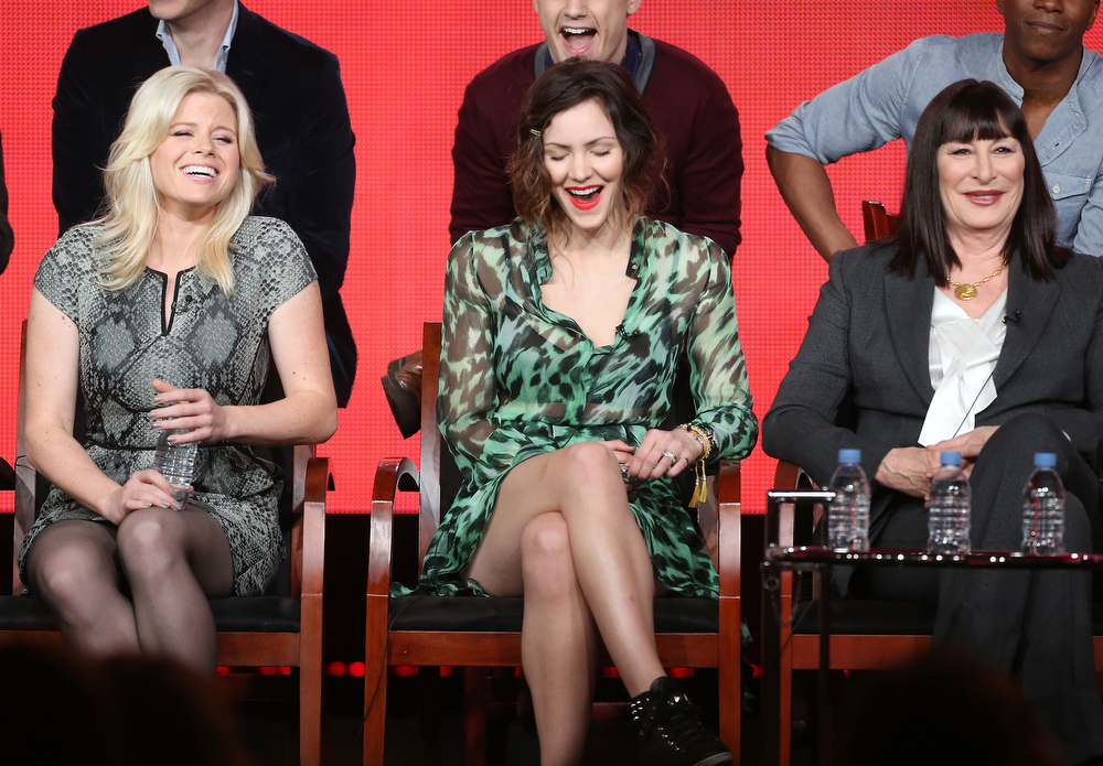 Description of . Actresses Megan Hilty, Katharine McPhee, and Anjelica Huston speak onstage during the