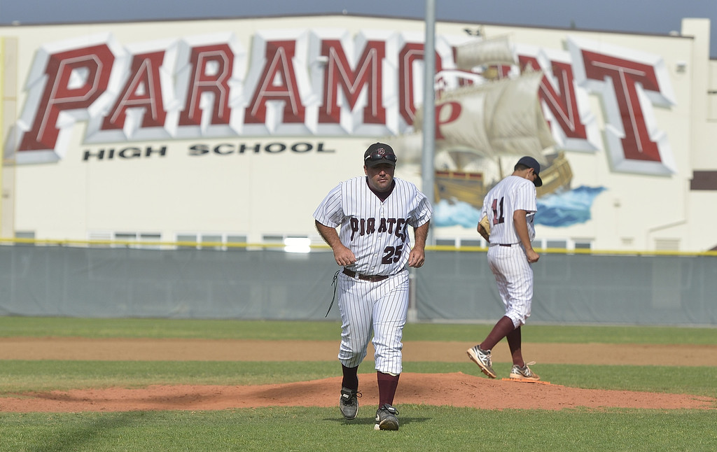 . PARAMOUNT, CALIF. USA -- Paramount Manager Cameron Chinn leaves the mound after talking with pitcher Ulices Moreno (11) during their CIF-SS Division III playoff loss to Westminster in Paramount, Calif., on Thursday, May 16, 2013. Westminster defeated Paramount, 3 to 0.  Photo by Jeff Gritchen / Los Angeles Newspaper Group