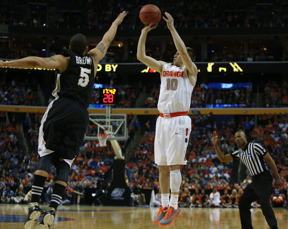 . Syracuse\'s Trevor Cooney (10) puts up a 3-pointer over Western Michigan\'s David Brown (5) in a second-round game of the NCAA college basketball tournament in Buffalo, N.Y., Thursday, March 20, 2014.  (AP Photo/The Buffalo News, Robert Kirkham) TV OUT; MAGS OUT; MANDATORY CREDIT; BATAVIA DAILY NEWS OUT; DUNKIRK OBSERVER OUT; JAMESTOWN POST-JOURNAL OUT; LOCKPORT UNION-SUN JOURNAL OUT; NIAGARA GAZETTE OUT; OLEAN TIMES-HERALD OUT; SALAMANCA PRESS OUT; TONAWANDA NEWS OUT