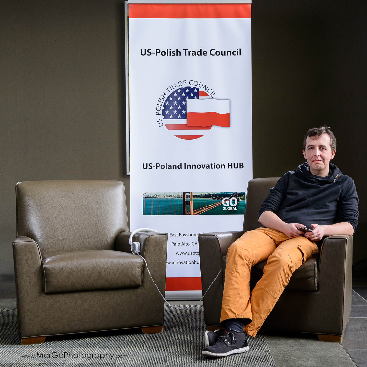 business portrait of a man sitting on the chairs