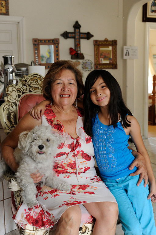 . Juanita Chavez, 69, of Los Angeles has raised her great-grandaughter Victoria Licea,7,since she was 1-month old. Chavez, who still has a home mortgage, works part-time giving manicures and pedicures at clients\' homes and struggles to make ends meet. Chavez is also taking care of her own daughter, who recently had a heart attack. A recent report by the UCLA Center for Health Policy Research has found that about 40 percent of older grandparents who are responsible for their grandchildren in the state do not have enough income to make ends meet.Los Angeles, CA. 7/11/2013(John McCoy/LA Daily News)