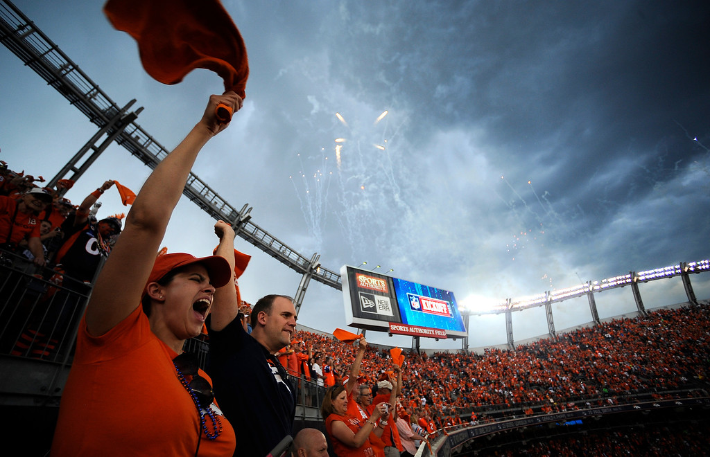 . Broncos fans cheer as the Broncos take the field before the game.  (Photo by AAron Ontiveroz/The Denver Post)