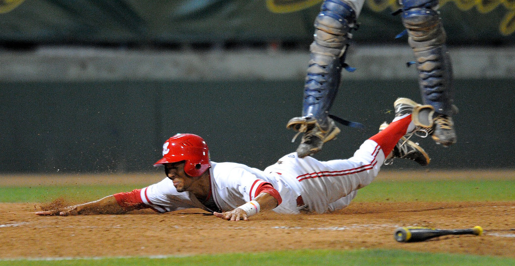 . LONG BEACH - 05/01/13 - (Photo: Scott Varley, Los Angeles Newspaper Group)  Lakewood vs Millikan baseball at Blair Field. Lakewood won 4-3. Lakewood\'s J.P. Crawford slides to score the winning run in the bottom of the 7th as Millikan catcher Giovanny Higueros leaps for a high throw.