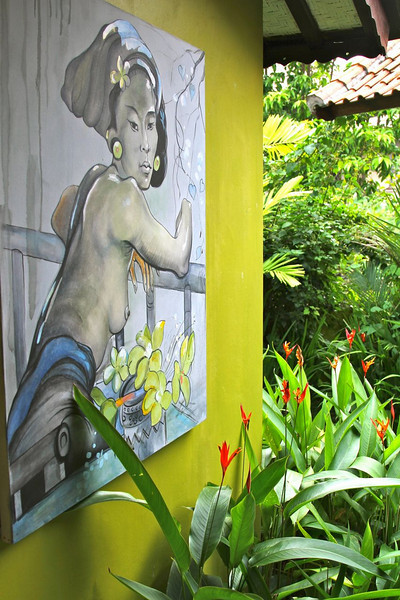 Gorgeous artwork and color combo leading into outdoor bath area