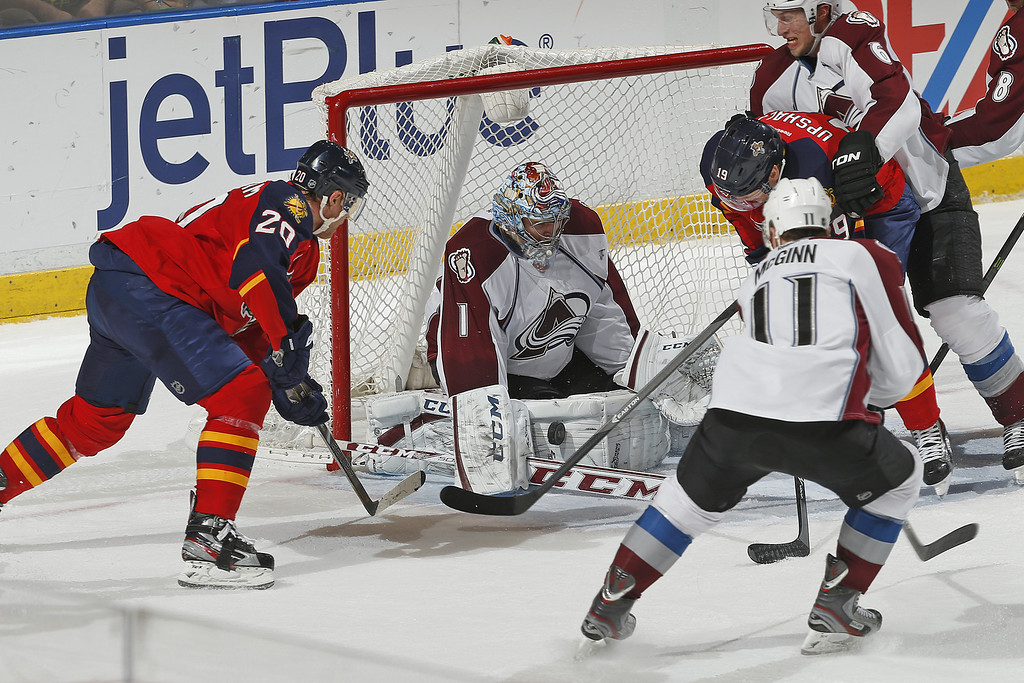 . SUNRISE, FL - JANUARY 24: Goaltender Semyon Varlamov #1 of the Colorado Avalanche makes a pad save as Sean Bergenheim #20 and Scottie Upshall #19 of the Florida Panthers attempt to control a rebound at the BB&T Center on January 24, 2014 in Sunrise, Florida. The Avalanche defeated the Panthers 3-2. (Photo by Joel Auerbach/Getty Images)