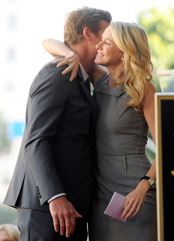 ". Actor Simon Baker gets a hug from actress Naomi Watts during a ceremony to award him a star on the Hollywood Walk of Fame, on Thursday, Feb. 14, 2013 in Los Angeles. Australian performers Baker and Watts worked together in the 2005 film ""The Ring Two.\"" (Photo by Chris Pizzello/Invision/AP)"