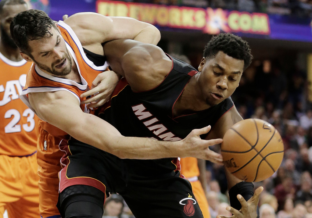 . Cleveland Cavaliers\' Kevin Love, left and Miami Heat\'s Hassan Whiteside battle for the ball in the second half of an NBA basketball game Friday, Dec. 9, 2016, in Cleveland. The Cavaliers won 114-84. (AP Photo/Tony Dejak)