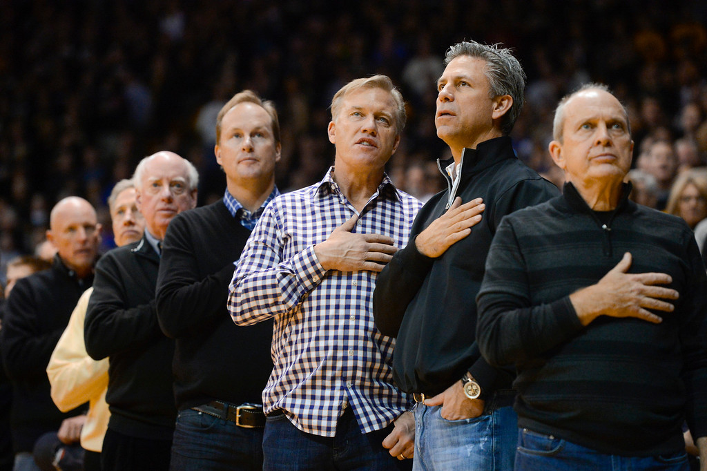 . Former Denver Broncos QB and current Denver Broncos executive vice president, John Elway, center, in attendance for the game against Colorado and Kansas Saturday afternoon, at the Coors Events Center December 07, 2013. (Photo By Andy Cross/The Denver Post)