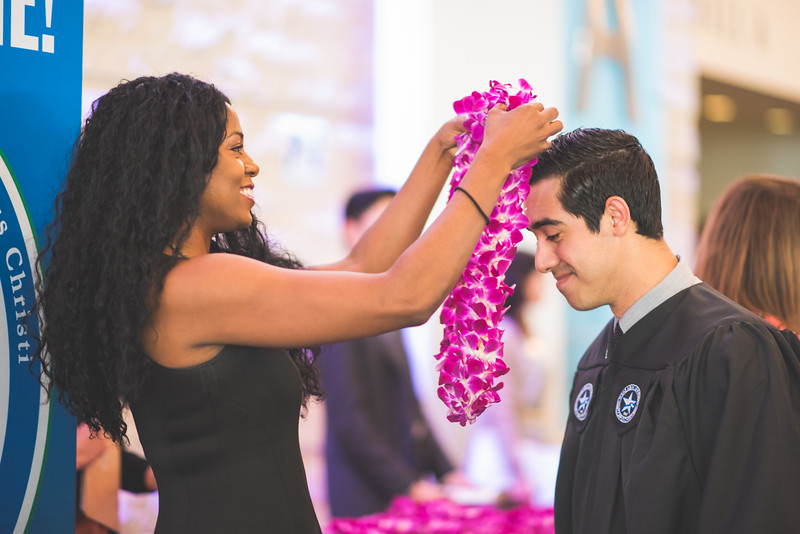 Jenesis Shaw places an Islander Lei on Carlos Bueno, as part of an Islander Tradition.