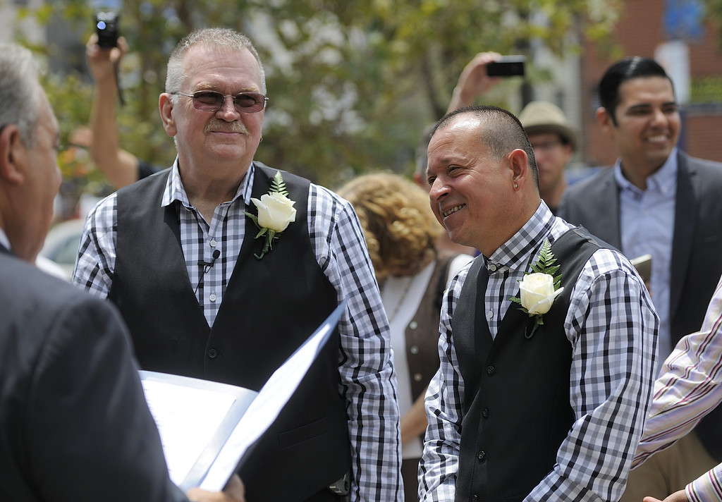 . LONG BEACH, CALIF. USA -- Long Beach residents Bob Crow, left, and Tony Almeida, get married at Harvey Milk Plaza in Downtown Long Beach, Calif., on July 1, 2013. Long Beach Mayor Bob Foster performed the marriage ceremony for the couple. Crow, who founded Long Beach Pride, asked Foster to perform the ceremony years ago.  Photo by Jeff Gritchen / Los Angeles Newspaper Group