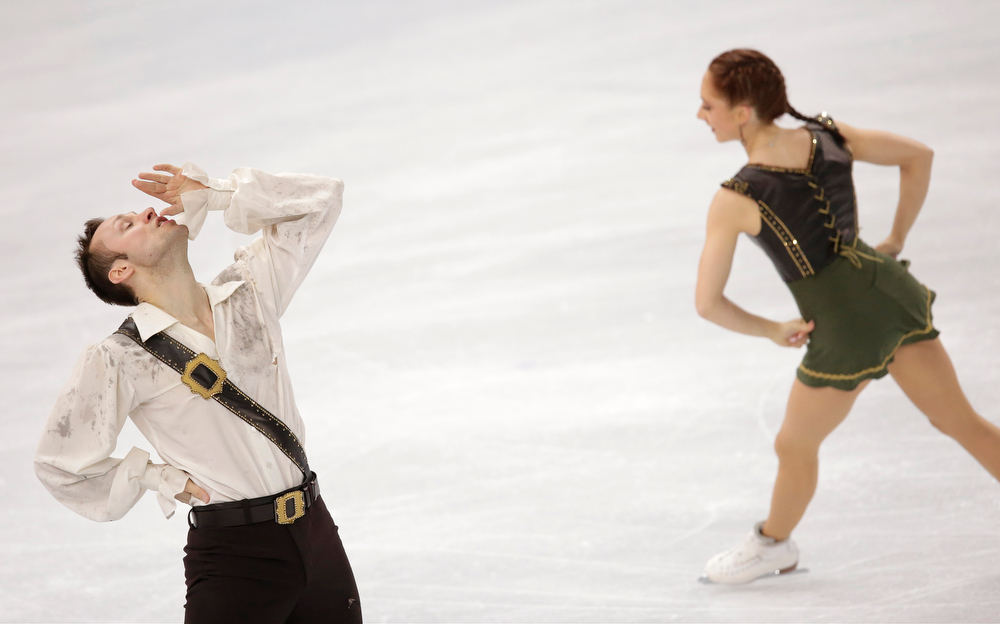 . Maylin Wende and Daniel Wende of Germany compete in the pairs free skate figure skating competition at the 2014 Winter Olympics, Wednesday, Feb. 12, 2014, in Sochi, Russia. (AP Photo/Bernat Armangue)