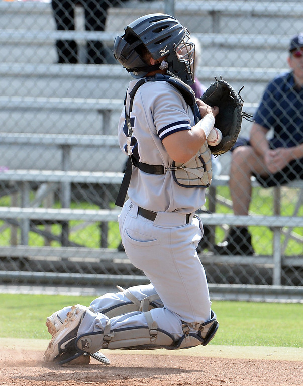 . La Salle\'s George Medina catches a foul pop-up by Bishop Amat\'s Christian Moya (not pictured) in the second inning of prep baseball game at Bishop Amat High School in La Puente, Calif., on Tuesday, May 6, 2014. (Keith Birmingham Pasadena Star-News)