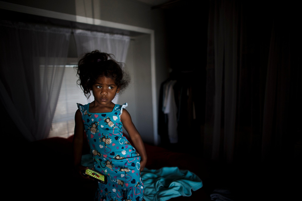 . After waking up,  Clarissa Taitano\'s 3-year-old daughter, I\'Yannah Jackson, waits for her mother\'s partner in the bedroom on May 24, 2013, in San Jose. Her family recently moved to their mobile home after living in a Santa Clara motel for 64 days. (Dai Sugano/Bay Area News Group)
