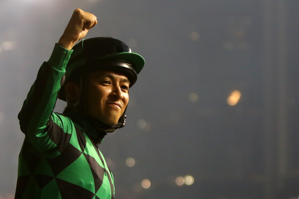 """. Japanese jockey Yuichi Fukunaga on his horse \""""Just A Way\"""" celebrates after winning the Dubai Duty Free race held on Dubai World Cup day on March 29, 2014 at Meydan racecourse in Dubai. A cosmopolitan gathering of horses from seven different countries contest the US$10 million Emirates Dubai World Cup at Meydan racecourse.    (MARWAN NAAMANI/AFP/Getty Images)"""