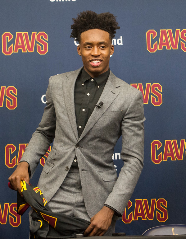 . Cleveland Cavaliers NBA basketball team first round draft selection, Collin Sexton, prepares to leave a news conference at the Cavaliers training facility in Independence, Ohio, Friday, June 22, 2018.  (AP Photo/Phil Long)