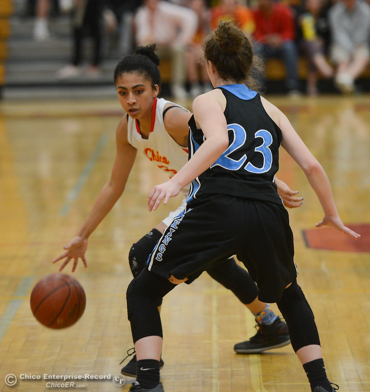 . Chico High\'s Adrianie Servin-Smith (23) tries to get past Pleasant Valley\'s Shaley Vieg (23), Thursday, February 8, 2018, in Chico, California. (Carin Dorghalli -- Enterprise-Record)