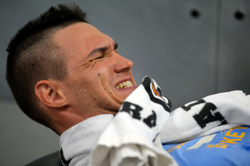 . Denver Nuggets Danilo Gallinari grimaces during a rigorous workout with assistant coach/strength and conditioning coach Steve Hess May 27, 2014 at Pepsi Center. (Photo by John Leyba/The Denver Post)