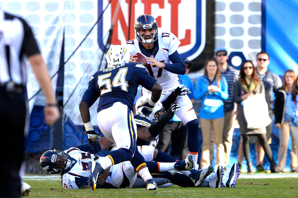 . SAN DIEGO, CA. December 14, - quarterback Brock Osweiler #17 of the Denver Broncos is called in late in the first half vs the San Diego Chargers at Qualcomm Stadium December 14, 2014 San Diego, CA (Photo By Joe Amon/The Denver Post)