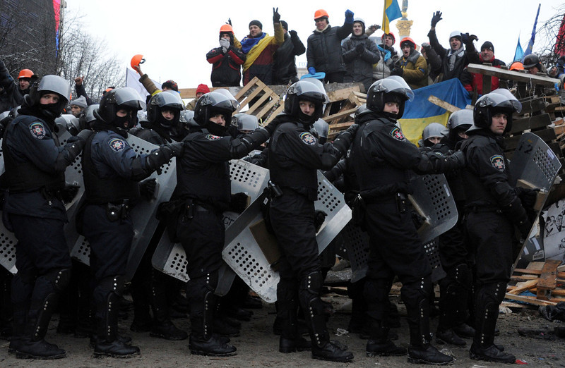 . Anti-Yanukovych protesters defend their barricades in front of anti-riot police on Independence Square in Kiev, on December 11, 2013. Ukrainian security forces pulled out of the epicentre of mass protests in Kiev today after a nine hour standoff with thousands of demonstrators, in a major boost for the opposition to President Viktor Yanukovych. VIKTOR DRACHEV/AFP/Getty Images