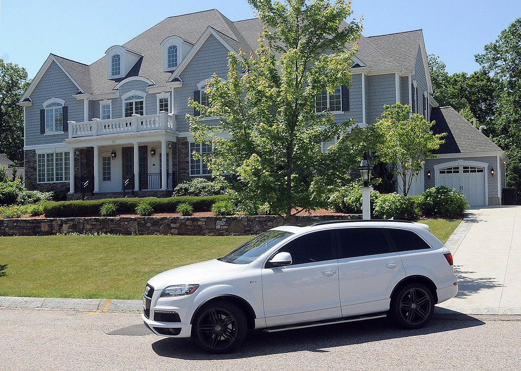 . New England Patriots tight end Aaron Hernandez drives from his home late Thursday morning, June 20, 2013, in North Attleborough, Mass. Hernandez had a connection to homicide victim Odin Lloyd, of Boston, whose body was found in an industrial park near the athlete\'s home. Family and officials were mum on the nature of their relationship Thursday, two days after police visited Hernandez\' home. (AP Photo/The Sun Chronicle, Mark Stockwell)