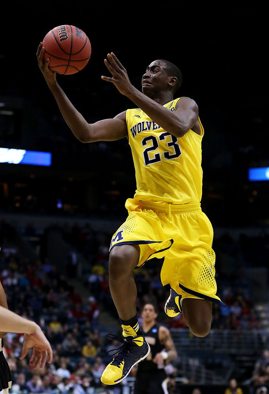 . Caris LeVert #23 of the Michigan Wolverines shoots against the Wofford Terriers in the first half during the second round of the 2014 NCAA Men\'s Basketball Tournament at BMO Harris Bradley Center on March 20, 2014 in Milwaukee, Wisconsin.  (Photo by Jonathan Daniel/Getty Images)
