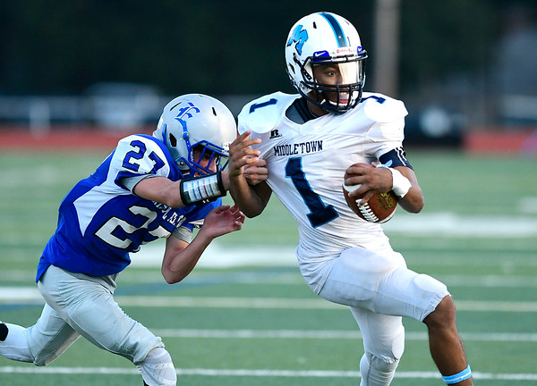 9/14/2018 Mike Orazzi | Staff Bristol Eastern's Carson Sassu (27) and Middletown's Jonta'e Dempsey-Brown (1) during Friday night's football game with Middletown in Brist