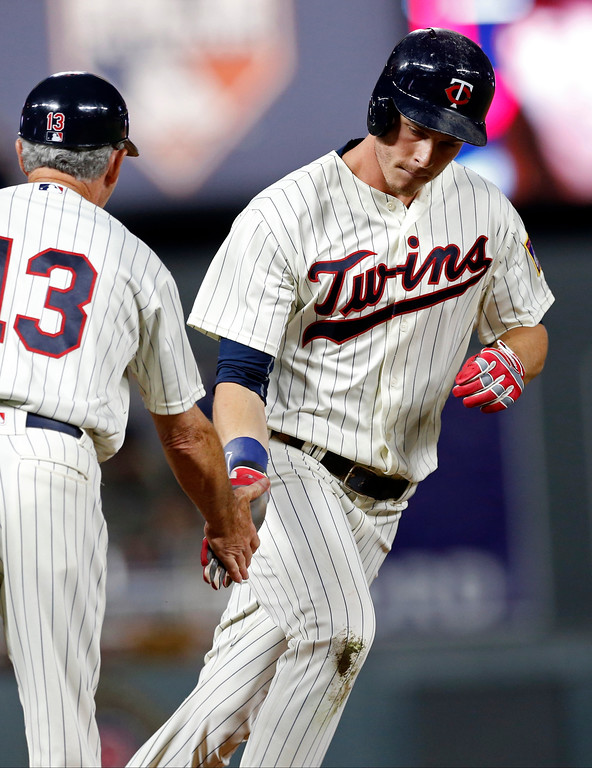. Minnesota Twins\' Max Kepler, right, rounds third base on a tie-breaking solo home run off Cleveland Indians pitcher Mike Clevinger during the seventh inning of the second game of a baseball doubleheader Thursday, Aug. 17, 2017, in Minneapolis. The Twins won 4-2. (AP Photo/Jim Mone)