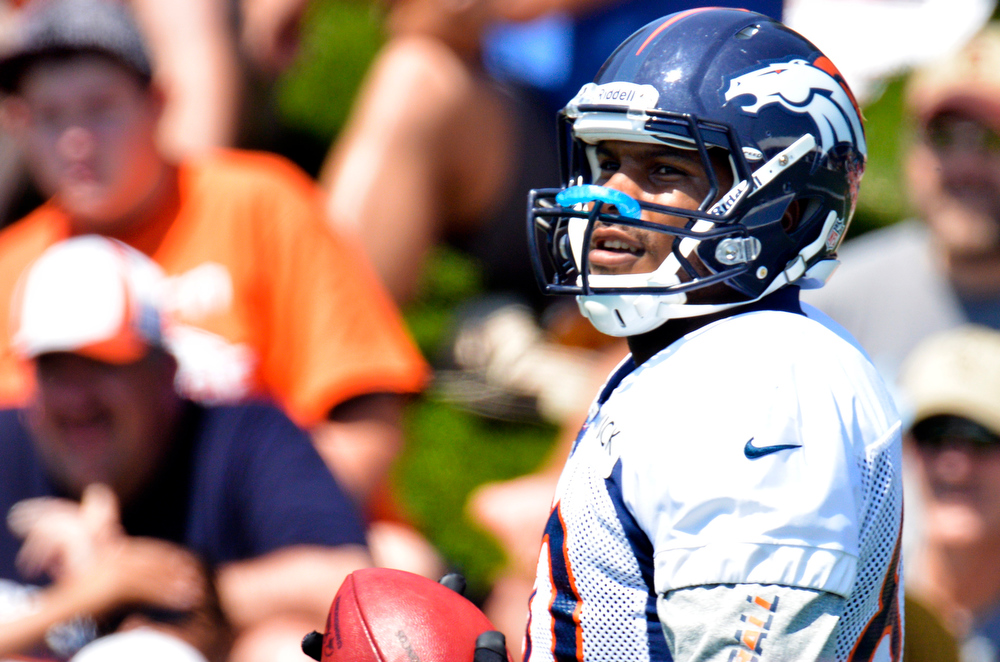 . Denver Broncos TE Julius Thomas catches a pass during training camp July 26, 2013 at Dove Valley. (Photo By John Leyba/The Denver Post)