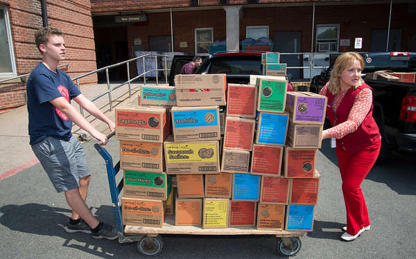 08/14/19 Wesley Bunnell | Staff VA volunteer Henry Sawyer, L, and Maria Bognar wheel a cart full of Girl Scout cookies into the Newington VA on Wednesday August 14, 2019. The cookies were donated by the Girl Scouts and delivered by fellow veterans and candidates for political office John Cain, Justin Anderson and Robert F Hyde.