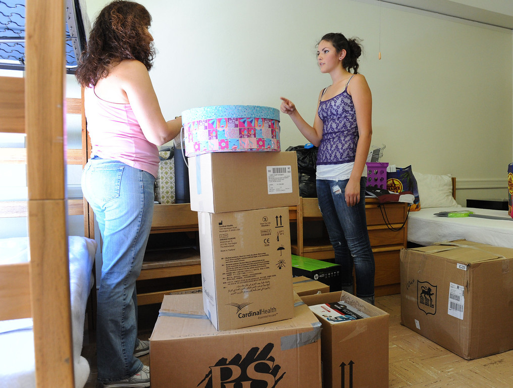 . (John Valenzuela/Staff Photographer) Freshman student Danielle Davis and her mother Mollie Andersen of San Diego, unpacks inside her dorm room, Wednesday morning during move-in day at the University of Redlands, August 28, 2013.