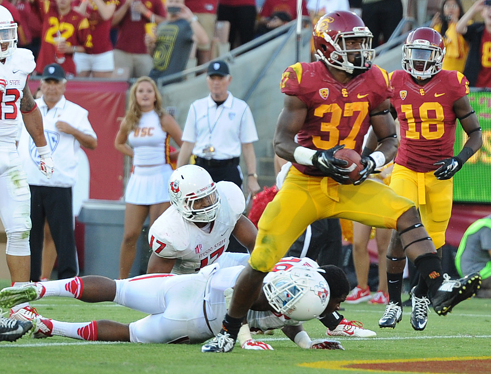 . #37 Javorius Allen ran over Fresno #28 Charles Washington for a score in the 3rd quarter. USC defeated Fresno State 52-13 at the Los Angeles Memorial Coliseum. Los Angeles, CA. 8/30/2014(Photo by John McCoy Daily News