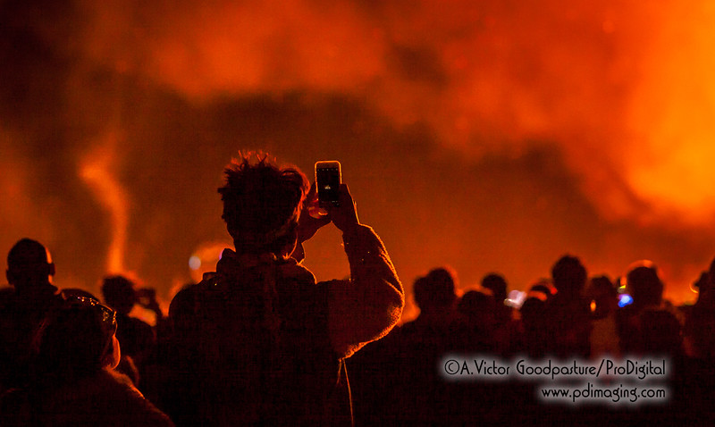 Burners capture The Man's burn with cell phone cameras.