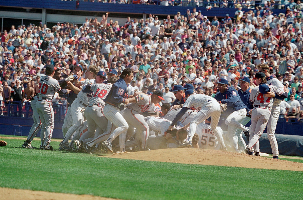 . New York Mets and Atlanta Braves players meet at the pitchers mount for a bench clearing brawl in the fifth inning of their game at Shea Stadium, Saturday, May 14, 1994, New York. The fight broke out after Mets right fielder John Cangelosi was hit by a pitch from Braves pitcher John Smoltz. Both were ejected from the game which Mets won 11-4. (AP Photo/Kevin Larkin)