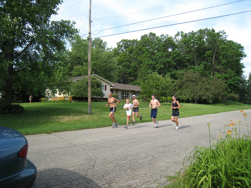 The runners pass by. One more lap to go!