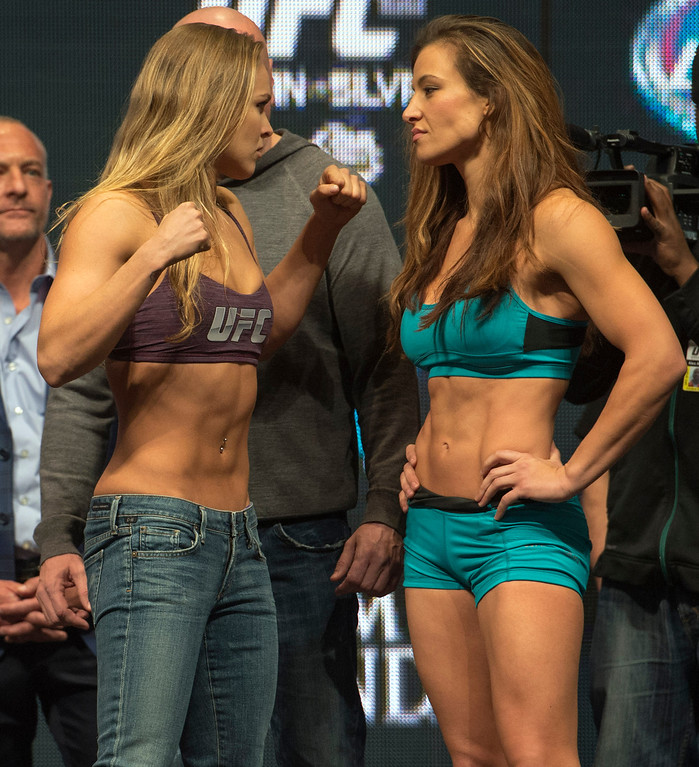 . UFC Woman\'s Bantamweight Champion Ronda Rousey and challenger Miesha Tate square off after both weighing in at 135 lbs  at the MGM Grand in Las Vegas Friday, December 27, 2013. Rousey will be defending her belt during UFC 168, in a rematch against Tate on Saturday at the MGM Grand Garden Arena. (Photo by Hans Gutknecht/Los Angeles Daily News)
