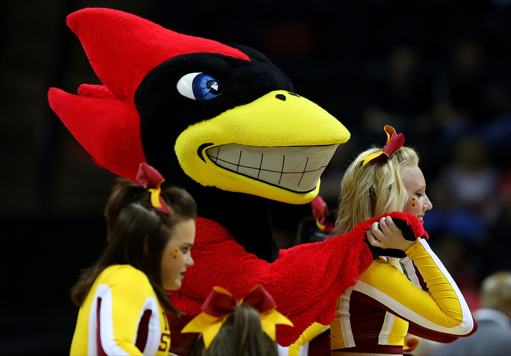 . The Iowa State Cyclones mascot performs during a timeout of the Cyclones and North Carolina Central Eagles game during the second round of the 2014 NCAA Men\'s Basketball Tournament at AT&T Center on March 21, 2014 in San Antonio, Texas.  (Photo by Ronald Martinez/Getty Images)