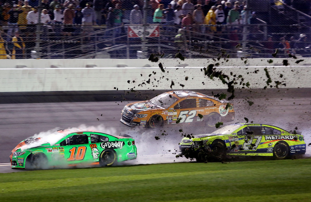 . Danica Patrick, driver of the #10 GoDaddy Chevrolet, and Paul Menard, driver of the #27 Peak/Menard\'s Chevrolet, are involved in an incident during the NASCAR Sprint Cup Series Daytona 500 at Daytona International Speedway on February 23, 2014 in Daytona Beach, Florida.  (Photo by Jerry Markland/Getty Images)