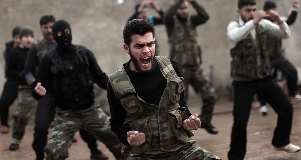 . In this Dec. 17, 2012 file photo, Syrian rebels attend a training session in Maaret Ikhwan near Idlib, Syria. For Syria\'s banned Muslim Brotherhood, the uprising against President Bashar Assad that erupted amid Arab Spring revolts in 2011 provided a long-sought opportunity to stage a comeback after decades spent in exile. (AP Photo/Muhammed Muheisen)