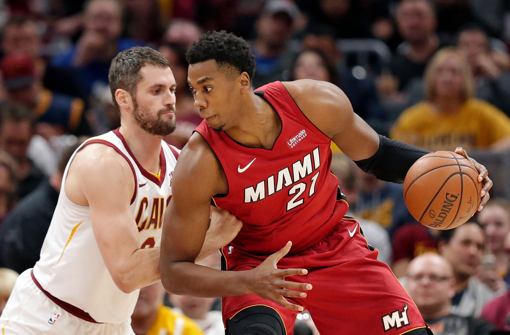 . Miami Heat\'s Hassan Whiteside (21) drives past Cleveland Cavaliers\' Kevin Love (0) in the first half of an NBA basketball game, Tuesday, Nov. 28, 2017, in Cleveland. (AP Photo/Tony Dejak)