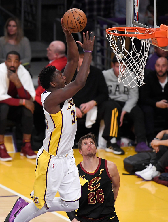 . Los Angeles Lakers forward Julius Randle, left, shoots as Cleveland Cavaliers guard Kyle Korver defends during the second half of an NBA basketball game, Sunday, March 11, 2018, in Los Angeles. The Lakers won 127-113. (AP Photo/Mark J. Terrill)