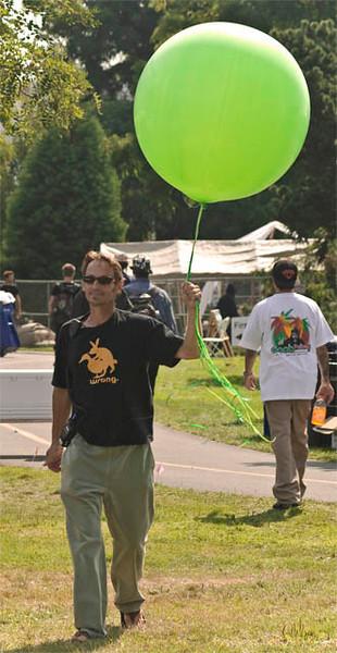 Volunteer with Green Balloon.jpg
