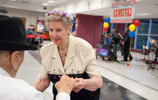 04/19/18 Wesley Bunnell | Staff Mary Lou Cunningham helps 93 year old WWII Veteran George Goldfuss dance Thursday night at TRIAD's 20th annual senior prom held at New Britain High School which featured a carnival theme. Cunningham and Goldfuss would be named co king and queen of the prom.