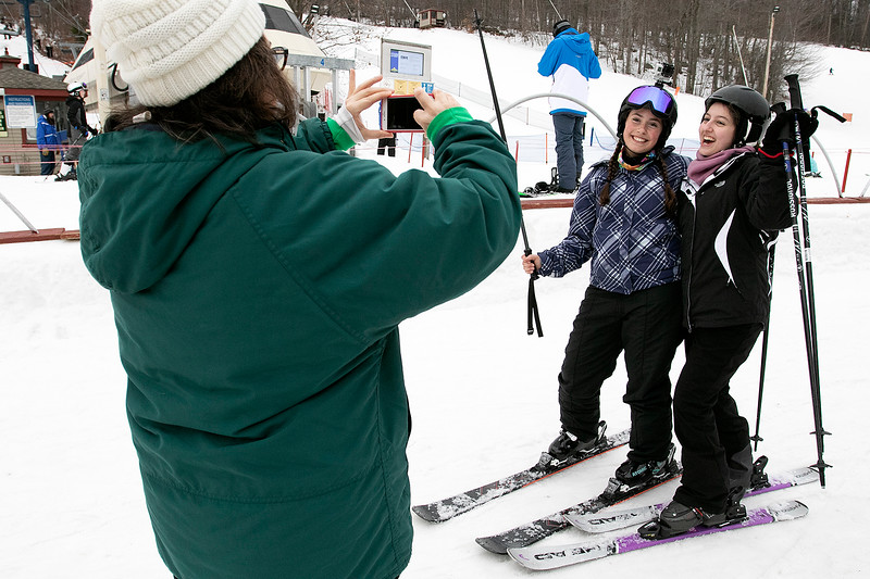 Many enjoy Wachusett Mountain Ski Area in Princeton on Friday, Jan. 10, 2020. Kelly Berthiaume takes a picture of her daughter Emily, 18 on left, from Hanson and Sara McCaffrey, 16, from Turkey. Emily was taking Sara up the mountain for her first time. SENTINEL & ENTERPRISE/JOHN LOVE