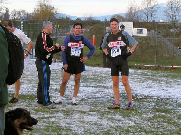 2005 Canadian XC Championships - Club manager Bob Reid greets Arturo and Richard