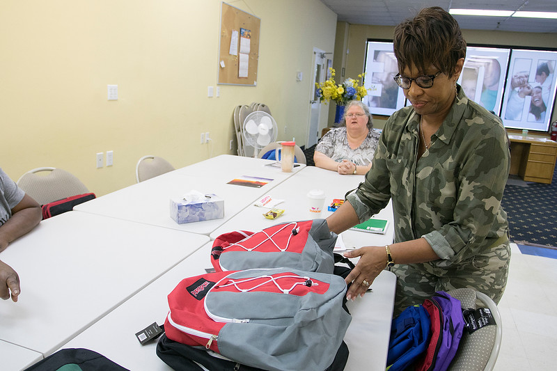 The Hope Center Project in Fitchburg on Harvard Street distributed back packs for school to area kids on Saturday, August, 25, 2019. Organizing the packs in age groups is Deaconess with New Hope Community Church and Director of the backpack program Karen Talbert. SENTINEL & ENTERPRISE/JOHN LOVE