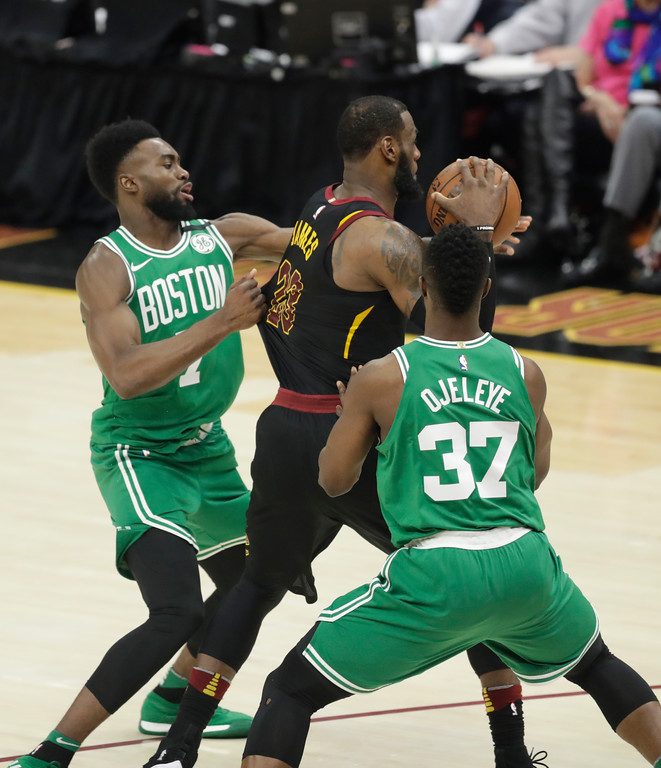 . Boston Celtics\' Semi Ojeleye (37) and Jaylen Brown double team Cleveland Cavaliers\' LeBron James (23) in the second half of Game 3 of the NBA basketball Eastern Conference finals, Saturday, May 19, 2018, in Cleveland. (AP Photo/Tony Dejak)