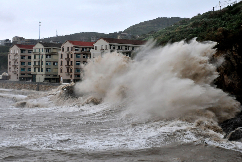 . Huge waves hit the dike as Typhoon Fitow moves to make its landfall in Wenling, east China\'s Zhejiang province on October 6, 2013.  China was on its highest alert for Typhoon Fitow on October 6, with tens of thousands evacuated as the storm was set to slam into the east coast.   STR/AFP/Getty Images