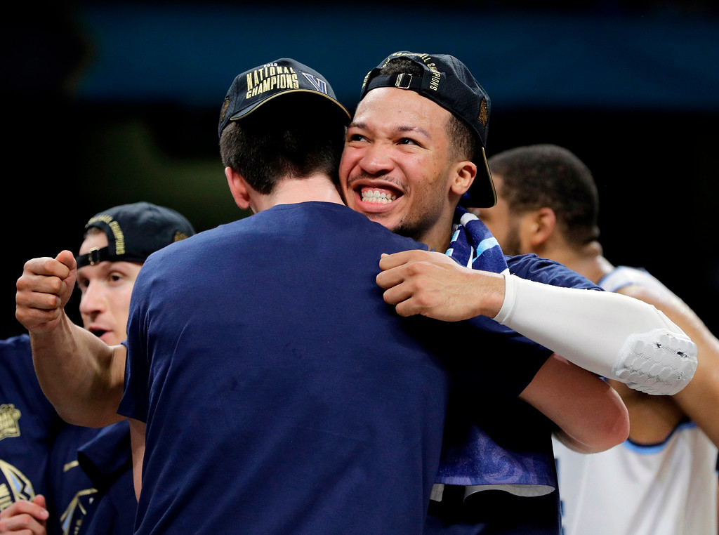 . Villanova\'s Jalen Brunson celebrates with his teammates after the championship game of the Final Four NCAA college basketball tournament against Michigan, Monday, April 2, 2018, in San Antonio. Villanova won 79-62. (AP Photo/David J. Phillip)