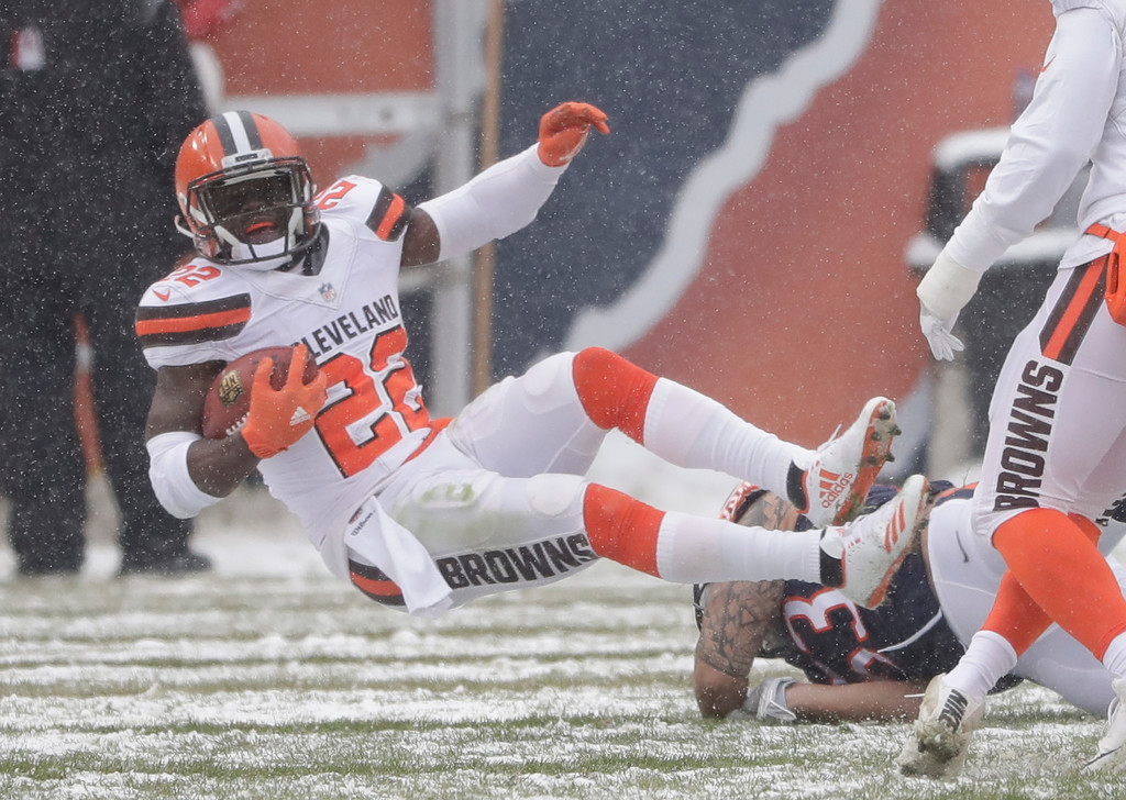 . Chicago Bears inside linebacker John Timu (53) tackles Cleveland Browns\' Jabrill Peppers (22) in the first half of an NFL football game in Chicago, Sunday, Dec. 24, 2017. (AP Photo/Charles Rex Arbogast)